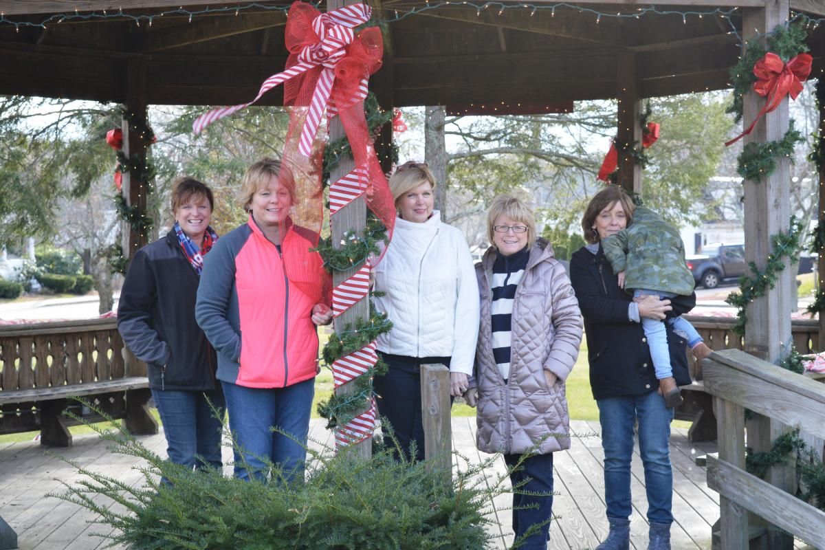 Rhona Clermont, RN, Janet Crimmins, RN, Janiece Bruce, RN Director, Linda Twomsley and Patty Muradian decorate the gazebo at Faxon Park.