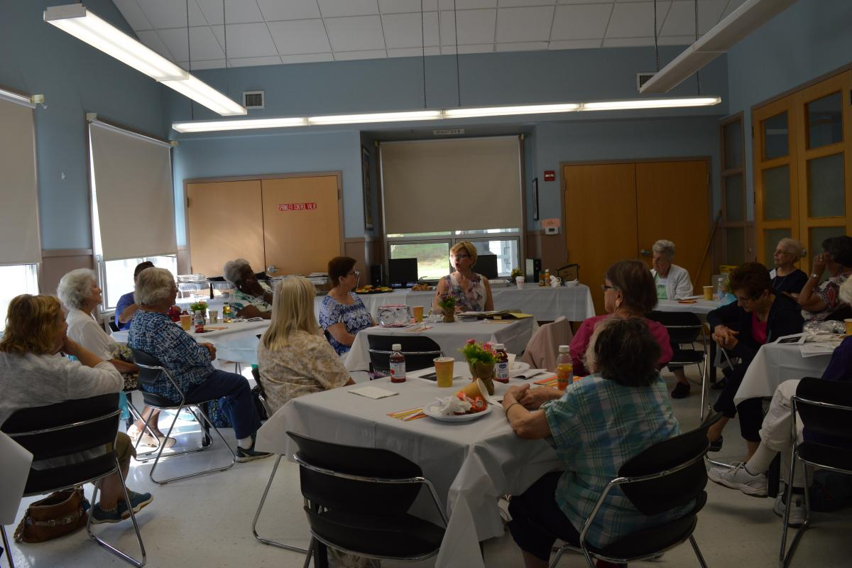 """Janiece Bruce, Administrator of Stoughton Public Health gives a history of the Visiting Nurses of Stoughton during """"Bunny's Breakfast"""" at the Senior Center."""