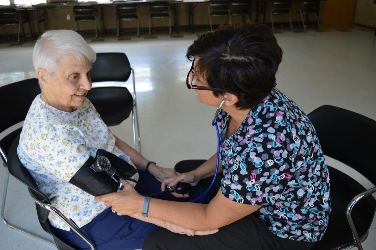 Evelyn Callanan has her blood pressure checked by Teresa Dolloff, RN at the weekly blood pressure clinic held at the Senior Center.
